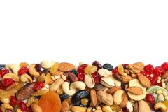 Different dried fruits and nuts on white background, top view. Space for text stock image