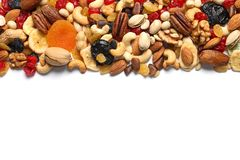Different dried fruits and nuts on white background, top view. Space for text stock photo
