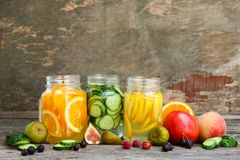 Different drinks, fruits and vegetables. On wooden background royalty free stock photo