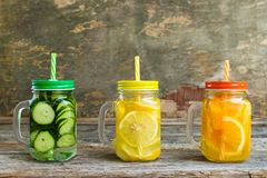 Different drinks of fruits and vegetables. On old wooden background royalty free stock images