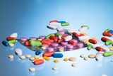 Different drug pills scattered Royalty Free Stock Photography