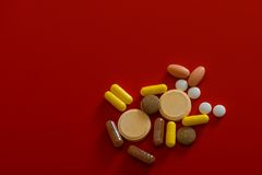 Different drugs  on red Stock Photography