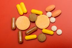 Different drugs  on red Royalty Free Stock Photos