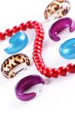 Different ear-rings and red beads Stock Photo