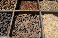 Different eastern spices in sections for sale at arabian market Stock Photos
