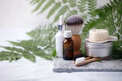 Different eco friendly cosmetic products in bathroom. Minimizing ecological footprint concept. Bamboo bath towel, biodegradable. Bamboo toothbrush, aroma oil stock images