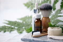 Different eco friendly cosmetic products in bathroom. Minimizing ecological footprint concept. Bamboo bath towel, biodegradable. Bamboo toothbrush, aroma oil royalty free stock photos