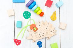 Different educational wooden toys on a white wooden background. royalty free stock images