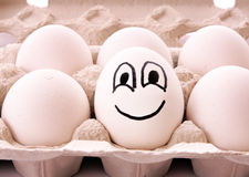 Different egg with smile Royalty Free Stock Photos