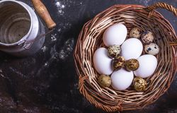 Different eggs in a wicker basket. stock photo
