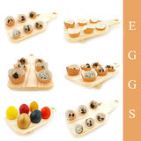 Different eggs in the wooden board Royalty Free Stock Photography