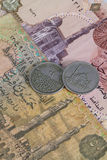 Different Egyptian coins and banknotes on the desk Royalty Free Stock Photo
