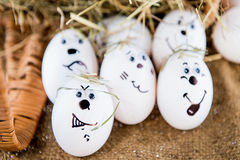 Different emotion faces eggs. Different emotion faces made of white eggs stock photos