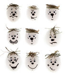 Different emotion faces. Made of white eggs set on white Stock Photography