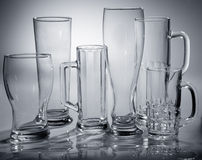 Different empty glasses of beer Stock Photos