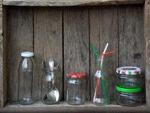 Different empty jar and bottles. Still life with glassware on wood table royalty free stock photography