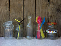 Different empty jar and bottles. On wooden background stock images