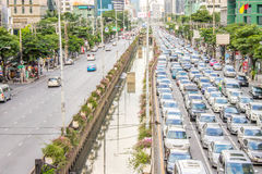 Different of empty road and traffic jam in city center Sathon Ba. Different of Road empty and traffic jam in city center Sathon Bangkok, Thailand.  cars join the Royalty Free Stock Images
