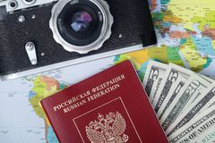 Items for traveling - camera, passport, map - flat lay with copy space. Different essential items for journey - photocamera, passport, money and map royalty free stock images