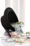 Different Euro bank notes, Top hat and magic wand Royalty Free Stock Image