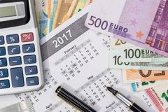 Different euro bills with 2017 calendar. And pen Royalty Free Stock Photo