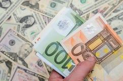 Different euro and dollar bills Stock Photos