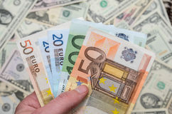 Different euro and dollar bills Stock Photo