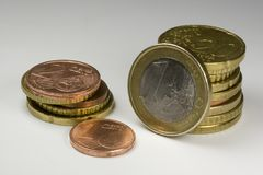 Loose change on a white background. Different euro and penny  coins are ready to pay or change Royalty Free Stock Photo