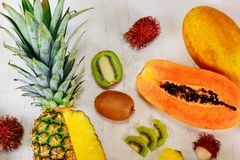 Different exotic fruits on white background, flat lay stock image