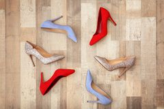 Different female shoes on floor. Top view royalty free stock image