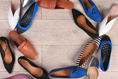 Different female shoes on wooden background. Top view royalty free stock images