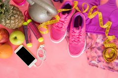 Different fitness objects on pink surface Stock Photos