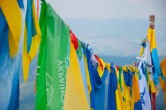 Different flags on the top of the mountain Stock Photos