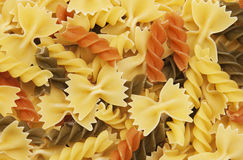 Different flavors of fusilli twirls pasta. Italian food background Royalty Free Stock Photography