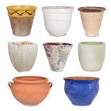 Different flowerpots, isolated. Different flower pots and cachepots, isolated Royalty Free Stock Images