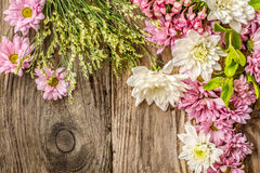 Different flowers on the wooden background top view Royalty Free Stock Photo