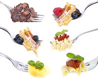 Different food on Forks Royalty Free Stock Images