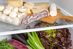 Different food products inside a refrigerator Stock Photos