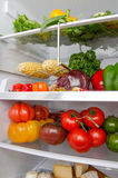 Different food products inside a refrigerator Royalty Free Stock Photos