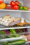 Different food products inside a refrigerator Royalty Free Stock Photo