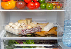 Different food products inside a refrigerator Royalty Free Stock Image