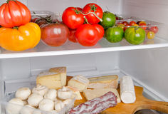 Different food products inside a refrigerator Stock Images