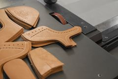 Free Different Forms Of Leather Pieces Which Will Be Use For Making A Shoes On A Shoes Factory. Prepared, Bundled Leather Royalty Free Stock Photography - 160905727