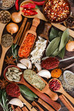Different fragrant spices on wooden background. Stock Photos