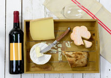 Different french cheeses with red wine Royalty Free Stock Photography