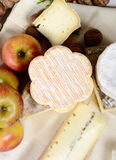 Different french cheeses with several apples Stock Photo