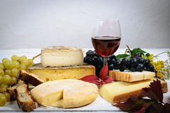 Different French Savoie cheeses with a glass of red wine Royalty Free Stock Photo