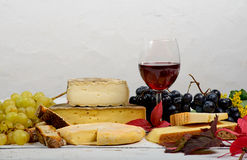 Different French Savoie cheeses with a glass of red wine Royalty Free Stock Photos