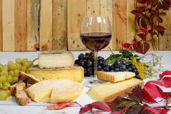 Different French Savoie cheeses with a glass of red wine Stock Photo