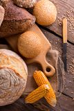Fresh bread and wheat on the wooden stock photos